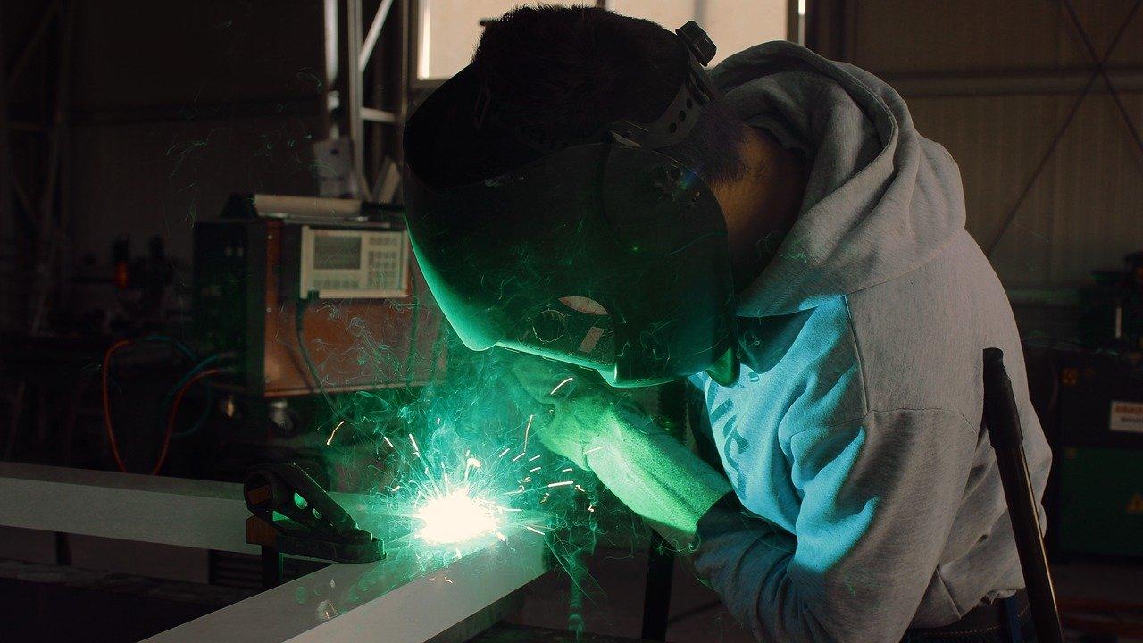 Stock image of man welding