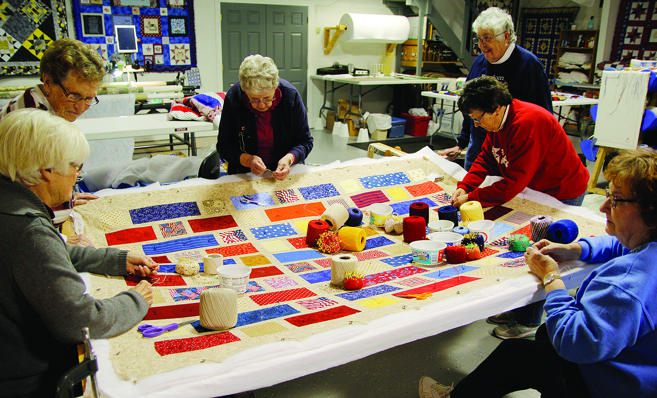 Volunteers working on a quilt at Freedom Quilts near Varina