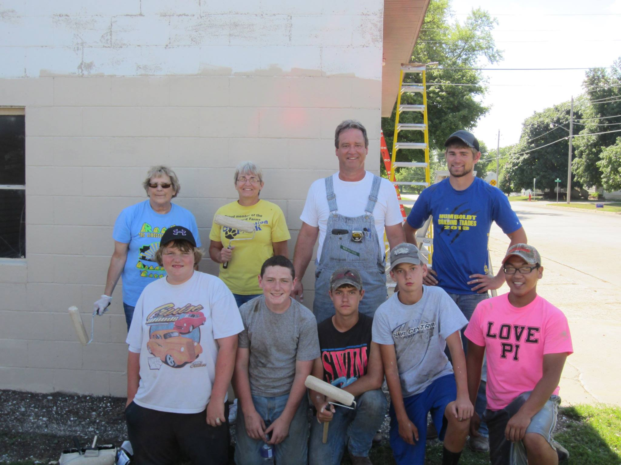 Gilmore City Hometown Pride volunteers working on Paint Iowa Beautiful grant project