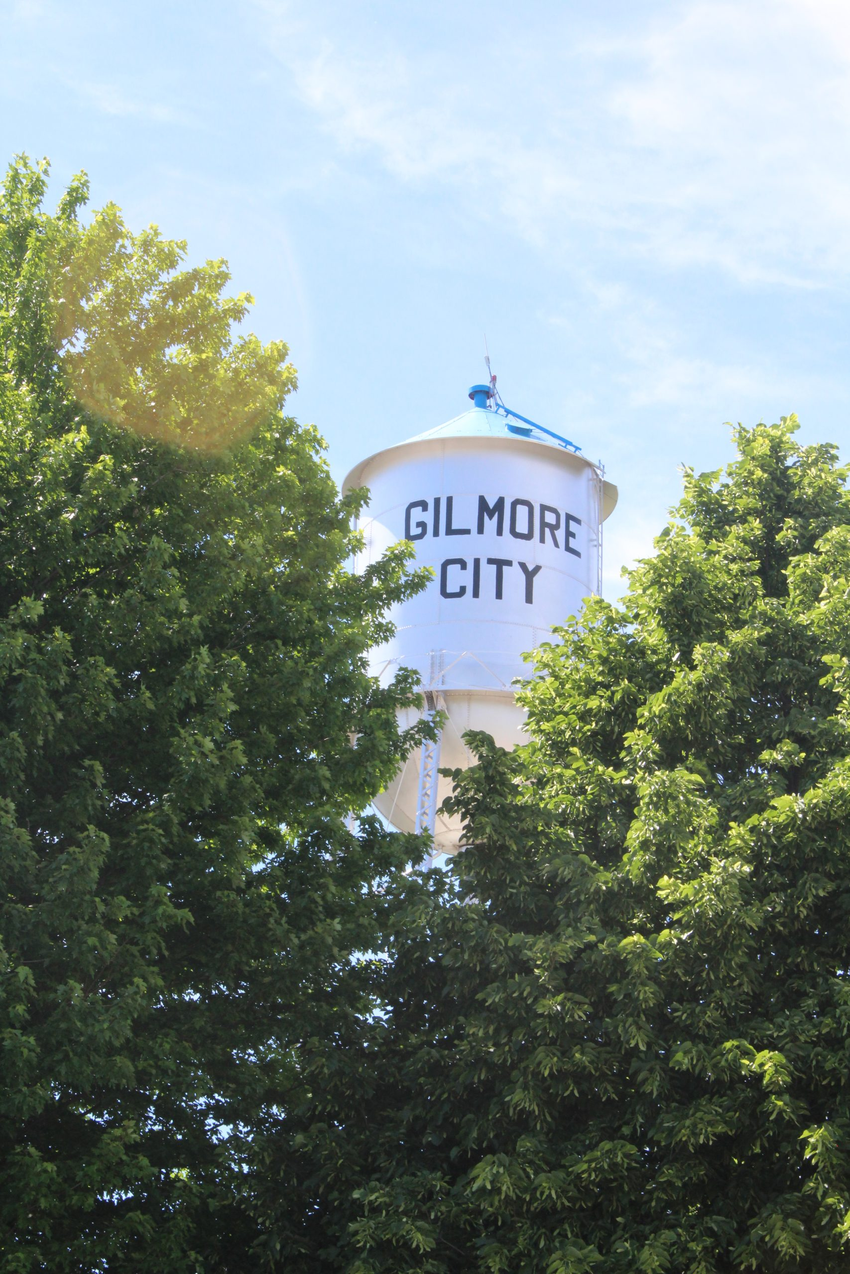 View of Gilmore City water tower through trees