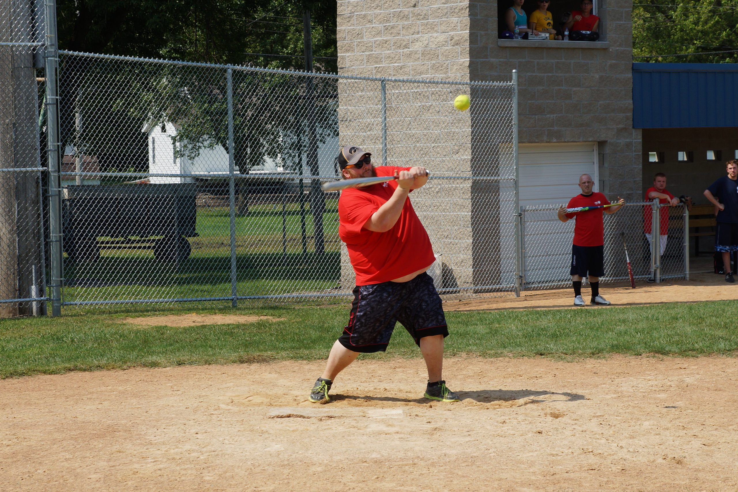 Ryan Shaffer, Manager of the HWY 7 slow pitch team takes a cut at the ball
